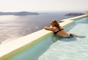 Marissa Liesenfelt at Astra Suites in the pool in Santorini, Greece