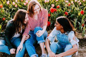 Three women traveling in a flower field