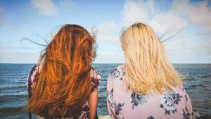 Two women looking at the ocean