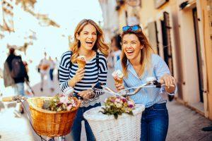 Two women eating gelato in Italy