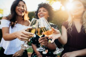 Women cheers with champagne