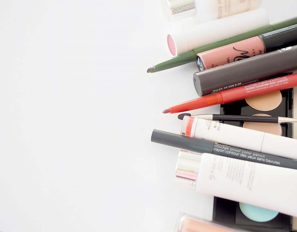 An assortment of the best travel makeup products.
