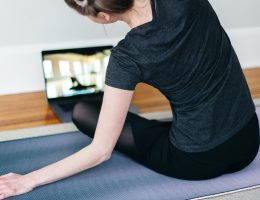 Woman doing an at home workout with an app on her laptop
